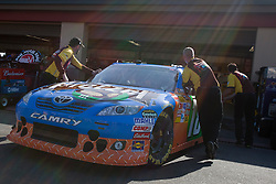June 25, 2011; Sonoma, CA, USA;  Crew members push the car of NASCAR Sprint Cup Series driver Kyle Busch (not pictured) into the garage during practice for the Toyota/Save Mart 350 at Infineon Raceway.