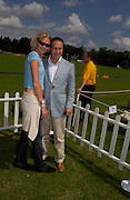John Remick ( Audi) and Jodie Kidd, Veuve Clicquot gold Cup, Polo at Cowdray, 18 July 2004. SUPPLIED FOR ONE-TIME USE ONLY> DO NOT ARCHIVE. © Copyright Photograph by Dafydd Jones 66 Stockwell Park Rd. London SW9 0DA Tel 020 7733 0108 www.dafjones.com
