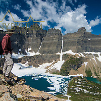 iceberg lake hiker looking down on lake from above