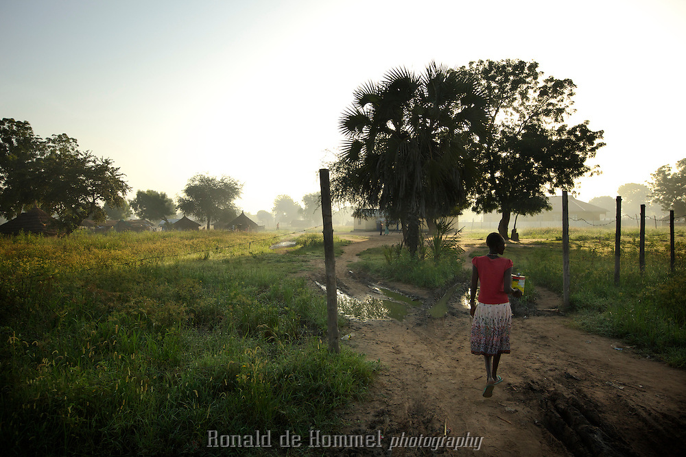 Early morning in Bor, Jonglei Stat, South Sudan. A woman walks on one of the main streets of the capital of Jonglei State.