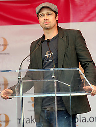 Dec 03 2007. New Orleans, Louisiana. Lower 9th Ward.<br /> Brad Pitt revisits the Lower 9th ward, devastated by Hurricane Katrina to present 'Make it Right' where architects' designs are unveiled to the public.<br />  Photo credit; Charlie Varley.