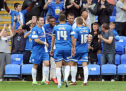 Peterborough United's Britt Assombalonga celebrates scoring  - Photo mandatory by-line: Joe Dent/JMP - Tel: Mobile: 07966 386802 17/08/2013 - SPORT - FOOTBALL - London Road Stadium - Peterborough -  Peterborough United V Oldham Athletic - Sky Bet League One