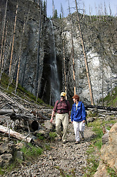 WY: Wyoming; Yellowstone National Park.In Midway Geyser Basin.Couple hiking at Fairy Falls, Model Released.Photo #: yellow1493.Photo copyright Lee Foster, 510/549-2202, lee@fostertravel.com, www.fostertravel.com..