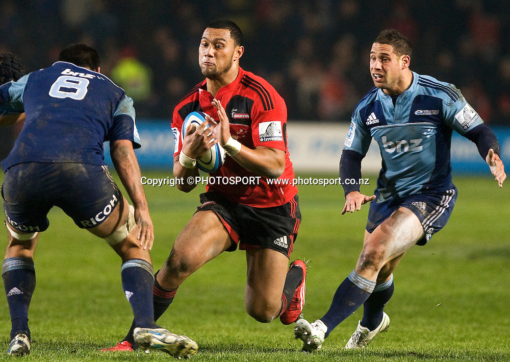 Robbie Fruean with the ball for the Crusaders in defence is Peter Saili (8) and Luke McAlister. Canterbury Crusaders v Auckland Blues at Alpine Energy Stadium, Timaru, New Zealand. Saturday 11 June 2011. Joseph Johnson/photosport.