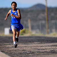 110114  Adron Gardner/Independent<br /> <br /> Navajo Pine Warrior Alvin Curley sprints to the finish line on the final stretch of the district cross country meet in Navajo Saturday. Curley's finished with a time of 18:58.