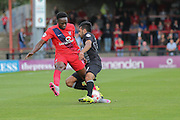 Mansfield Town defender Malvind Benning tries to tackle York City defender Marvin McCoy  during the Sky Bet League 2 match between York City and Mansfield Town at Bootham Crescent, York, England on 29 August 2015. Photo by Simon Davies.