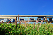 A trainspotter's paradise! All aboard the vintage train carriages turned into a seaside hotel on South Africa's Garden Route<br /> <br /> Your travel plans will be right on track with a stay at this South African hotel.<br /> The last stop at a the idyllic beach resort of Mossel Bay, between Cape Town and Port Elizabeth, is the spectacular Santos Express, made entirely out of old locomotive carriages.<br /> Simply dubbed 'The Train' by backpackers, the hostel is actually a series of bright blue carriages parked overlooking the spectacular bay.<br /> The unique hotel, which stands in view of the Outeniqua mountains, offers weary travellers braai`s -South African barbeques - as well as bunks and spectacular sea views.<br /> For those set on the finer things in life there are suites in two vintage coaches from the 1920s, called the 'Royal Ladies'.<br /> There isn't room for tea trolleys and sandwiches wheeled to peckish passengers room, but the quirky train also houses a 'cosy' bar and restaurant.<br /> Prices start from just 120 rand - £6 - for a room-only stay and lovers can splash out 980 rand per night - £54 - for a honeymoon caboose with bedding and a light breakfast.<br /> ©Santos Express/Exclusivepix