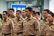 09 OCTOBER 2014 - BANGKOK, THAILAND:  Officers in the Royal Thai Navy line up before praying for Bhumibol Adulyadej, the King of Thailand in the lobby of Siriraj Hospital. The King has been hospitalized at Siriraj Hospital since Oct. 4 and underwent emergency gall bladder removal surgery Oct. 5. The King is also known as Rama IX, because he is the ninth monarch of the Chakri Dynasty. He has reigned since June 9, 1946 and is the world's longest-serving current head of state and the longest-reigning monarch in Thai history, serving for more than 68 years. He is revered by the Thai people and anytime he goes into the hospital thousands of people come to the hospital to sign get well cards.  PHOTO BY JACK KURTZ