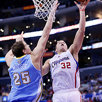 15 April 2014: Los Angeles Clippers forward Blake Griffin (32) goes for the layup past Denver Nuggets center Timofey Mozgov (25) during the Los Angeles Clippers 117-105 victory over the Denver Nuggets at the Staples Center, Los Angeles, California, USA.