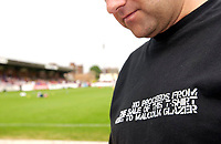 Picture by Daniel Hambury.<br /> 23/07/05.<br /> AFC wimbledon v Football Club United of Manchester. Pre season friendly.<br /> A FC United wears a shirt with reference to Manchester United chairman Malcom Glazer.