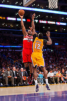 22 March 2013: Forward (13) Kevin Seraphin of the Washington Wizards shoots the ball over (12) Dwight Howard of the Los Angeles Lakers during the second half of the Wizards 103-100 victory over the Lakers at the STAPLES Center in Los Angeles, CA.