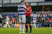 Queens Park Rangers forward Jordan Hugill (9) pleads with Referee Paul Tierney after he stuck two fingers up at Assistant Referee Darren Cann (not in picture) after being flagged off-side during the EFL Sky Bet Championship match between Queens Park Rangers and Swansea City at the Kiyan Prince Foundation Stadium, London, England on 21 August 2019.