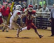 #40 Jarod Andrews running past the Longhorns #11 Austin Swann - Nicholas Rutledge / For The Transcript