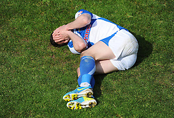 Bristol Rovers' Chris Beardsley lays on the floor with his hands over his face looking very dejected. - Photo mandatory by-line: Alex James/JMP - Mobile: 07966 386802 03/05/2014 - SPORT - FOOTBALL - Bristol - Memorial Stadium - Bristol Rovers v Mansfield - Sky Bet League Two