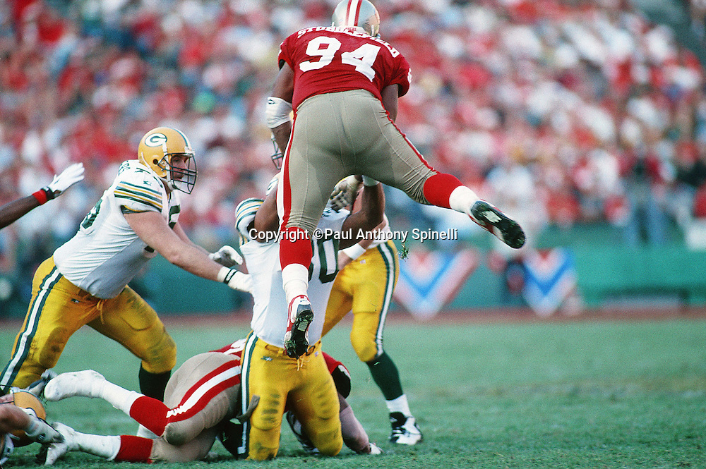 San Francisco 49ers defensive lineman Dana Stubblefield (94) leaps during the NFL NFC Divisional Playoff football game against the Green Bay Packers on Jan. 6, 1996 in San Francisco. The Packers won the game 27-17. (©Paul Anthony Spinelli)