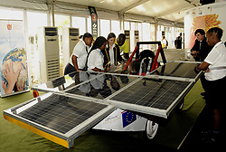 DURBAN, Nov. 30, 2011  Visitors look at a solar vehicle made by students from the Deutsche Schule zu Johannesburg (DSJ), at the South Africa Climate Change Response Expo, in Durban, South Africa, Nov. 29, 2011. The South Africa Climate Change Response Expo opened here on Monday, attracting more than 120 exhibitors from dirfferent countries and regions. (Credit Image: © Xinhua via ZUMA Wire)