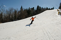 Spring conditions greet this skier coming down Trigger Trail from the top of the Panorama lift at Gunstock on Thursday afternoon.  (Karen Bobotas/for the Laconia Daily Sun)