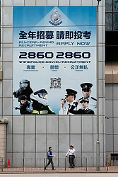 Exterior of Wanchai Police Station in Hong Kong showing recruitment poster on wall