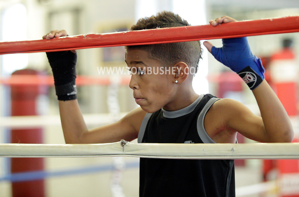 Terrence Thomas II, an 8-year-old boxer, takes a break while training at the Newburgh Boxing Club on Wednesday, Aug. 8, 2012.