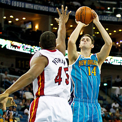 October 13, 2010; New Orleans, LA, USA; New Orleans Hornets power forward Jason Smith (14) shoots over Miami Heat center Dexter Pittman (45) during the second quarter of a preseason game at the New Orleans Arena. Mandatory Credit: Derick E. Hingle