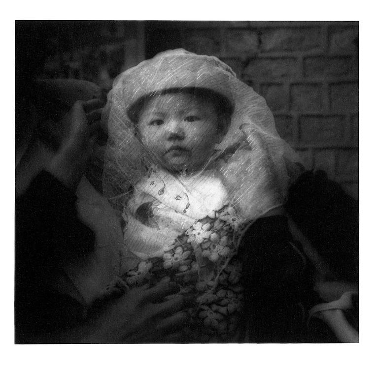 Veiled Infant, China. 1994