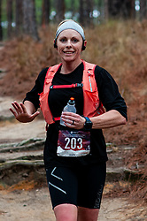 January 19, 2019 - Southern Pines, North Carolina, US - Jan. 19, 2019 - Southern Pines N.C., USA - Amanda Barnett, Lillington, North Carolina, completes a lap during the 10th Annual Weymouth Woods 100km ultra marathon at the Weymouth Woods Nature Preserve. Runners needed to complete 14 laps of the 4.47 mile course for 62.58 miles in under the 20-hour time allotment. (Credit Image: © Timothy L. Hale/ZUMA Wire)
