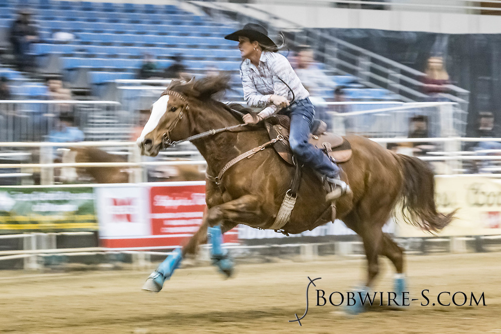 Barrel racer Pam Hollenbeck makes her run during slack at the Bismarck Rodeo on Saturday, Feb. 3, 2018. She had a time of 13.41 seconds. This photo and more from most runs are available at Bobwire-S.com.
