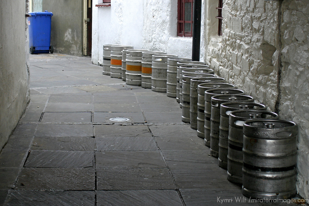 Europe, Ireland, Westport. Kegs in an alley.