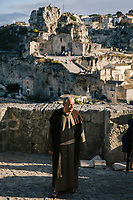 """MATERA, ITALY - 5 OCTOBER 2019: Raffaello De Ruggieri (84), mayor of Matera, is seen here performing in """"The New Gospel"""", a film by Swiss theatre director Milo Rau, in Matera, Italy, on October 5th 2019.<br /> <br /> Theatre Director Milo Rau filmed the Passion of the Christ  under the title """"The New Gospel"""" with a cast of refugees, activists and former actors from Pasolini and Mel Gibson's films.<br /> <br /> The role of Jesus is performed by Yvan Sagnet, a Political activist born in Cameroon and who worked on a tomato farm when in 2011 he revolted against the system of exploitation and led the first farm workers' strike in southern Italy. In a series of public shoots in the European Capital of Culture Matera, Jesus will proclaimed the Word of God, was crucified (October 6th 2019) and finally rose from the dead in Rome, the capital of Catholic Christianity and seat of one of the most xenophobic governments in Europe (October 10th 2019).<br />  <br /> Parallel to the film, the humanistic message of the New Testament was transformed into the present: at the beginning of September, the campaign """"Rivolta della Dignità"""" (Revolt of Dignity), which demanded fair working and living conditions     for refugees, global freedom of travel and civil rights for all, started with a march from the southern Italian refugee camps. """"It's about putting Jesus on his feet,"""" director Milo Rau said. Led by Jesus actor Yvan Sagnet, the campaign fights for the rights of migrants who came to Europe via the Mediterranean to be enslaved by the Mafia in the tomato fields of southern Italy and to live in ghettos under inhumane conditions. The campaign and the film thus create a """"New Gospel"""" for the 21st century, a manifesto of solidarity with the poorest, a revolt for a more just and humane world."""