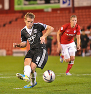 Picture by Richard Land/Focus Images Ltd +44 7713 507003<br /> 27/08/2013<br /> Steven Davis of Southampton makes it 4-1 from the penalty spot during the Capital One Cup match at Oakwell, Barnsley.
