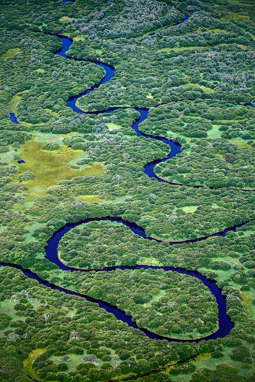 The Christina river in the boreal forest near Fort McMurray in Alberta, Canada. The Athabasca oil sands deposit is among the largest in the world, and huge surface mine operations dominate the landscape. The bitumen, also commonly named tar, contains lots of hydrocarbons, but is notoriously hard to extract. For every 100 BTU of energy extracted, 70 BTU is lost in the process. In 2011 alone, the oil sands operations in Canada produced 55 million tons of 'greenhouse gas emissions'. That's eight percent of Canada's total emissions.
