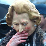 Crowds were taking turns to wear a mask and act like a Thatcher.