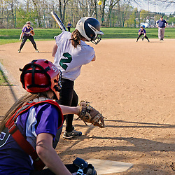 Staff photos by Tom Kelly IV<br /> Ridley's L. Locke (2) gets a hit during the Ridley at Upper Darby softball game on Wednesday.