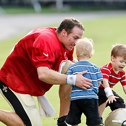July 28, 2012; Metairie, LA, USA; New Orleans Saints quarterback Drew Brees (9) plays with his two sons Bowen and Baylen (right) following a training camp practice at the team's practice facility. Mandatory Credit: Derick E. Hingle-US PRESSWIRE