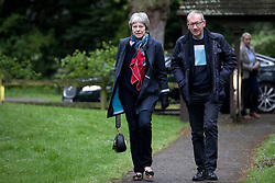Prime Minister Theresa May and her husband Philip arrive for a church service near her Maidenhead constituency.