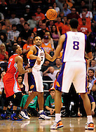 Apr. 1, 2011; Phoenix, AZ, USA; Phoenix Suns forward Grant Hill (33) makes a pass to teammate forward Channing Frye (8) while playing against the Los Angeles Clippers at the US Airways Center. The Suns defeated the Clippers 111-98. Mandatory Credit: Jennifer Stewart-US PRESSWIRE..