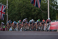 Riders in the Prudential RideLondon Grand Prix Youth Boys' Race come through onto The Mall. Prudential RideLondon is the world's greatest festival of cycling, involving 95,000+ cyclists – from Olympic champions to a free family fun ride - riding in five events over closed roads in London and Surrey over the weekend of 1st and 2nd August 2015.<br /> <br /> Photo: Thomas Lovelock for Prudential RideLondon<br /> <br /> See www.PrudentialRideLondon.co.uk for more.<br /> <br /> For further information: Penny Dain 07799 170433<br /> pennyd@ridelondon.co.uk