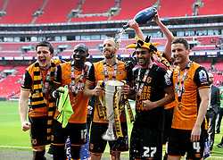 Harry Maguire, Mohamed Diame, David Meyler, Ahmed Elmohamady and Alex Bruce of Hull City celebrate winning promotion to The Premier League with The Playoff Final Trophy of Hull City - Mandatory by-line: Robbie Stephenson/JMP - 28/05/2016 - FOOTBALL - Wembley Stadium - London, England - Hull City v Sheffield Wednesday - Sky Bet Championship Play-off Final