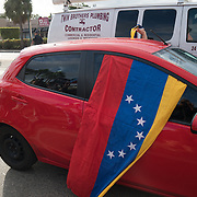 MIAMI, FL - NOVEMBER 26: A Venezuelan flag wrapped around a car as Miami residents react to the news of the death of former Cuban President Fidel Castro Ruz. Many, mostly Cubans, gathered outside popular Miami restaurant Versailles to wave flags and celebrate the news, on NOVEMBER 26, 2016 in Miami, Florida. (Photo by Angel Valentin/Getty Images)