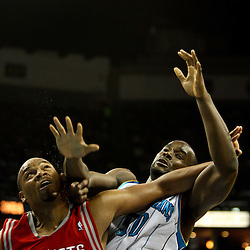 April 6, 2011; New Orleans, LA, USA; New Orleans Hornets center Emeka Okafor (50) and Houston Rockets center Chuck Hayes (44) battle for position on a rebound during the second half at the New Orleans Arena. The Hornets defeated the Rockets 101-93 and clinched a playoff spot with the victory.   Mandatory Credit: Derick E. Hingle-US PRESSWIRE