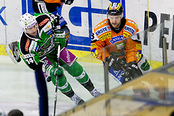 Matej Hocevar (HDD Tilia Olimpija, #14) and Robert Lembacher (Moser Medical Graz 99ers, #18) during ice-hockey match between HDD Tilia Olimpija and Moser Medical Graz 99ers in 42nd Round of EBEL league, on Januar 15, 2012 at Hala Tivoli, Ljubljana, Slovenia. HDD Tilia Olimpija defeated Moser Medical Graz 99ers 4:2. (Photo By Matic Klansek Velej / Sportida)