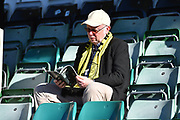 A Burton Albion fan reading a match day programme before the EFL Sky Bet League 1 match between Plymouth Argyle and Burton Albion at Home Park, Plymouth, England on 20 October 2018.