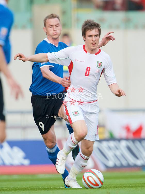 LLANELLI, WALES - Friday, May 29, 2009: Wales' Aaron Ramsey Estonia's Vitali Gussev during the International friendly match at Parc y Scarlets. (Pic by David Rawcliffe/Propaganda)