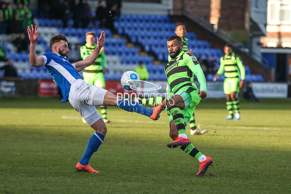 Forest Green Rovers Dan Wishart(17) and Macclesfield's Chris Holroyd battle for the ball during the FA Trophy match between Macclesfield Town and Forest Green Rovers at Moss Rose, Macclesfield, United Kingdom on 4 February 2017. Photo by Shane Healey.