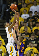 December 07 2010: Iowa Hawkeyes guard/forward Roy Devyn Marble (4) puts up a shot over Northern Iowa Panthers guard Marc Sonnen (23) during the first half of their NCAA basketball game at Carver-Hawkeye Arena in Iowa City, Iowa on December 7, 2010. Iowa defeated Northern Iowa 51-39.