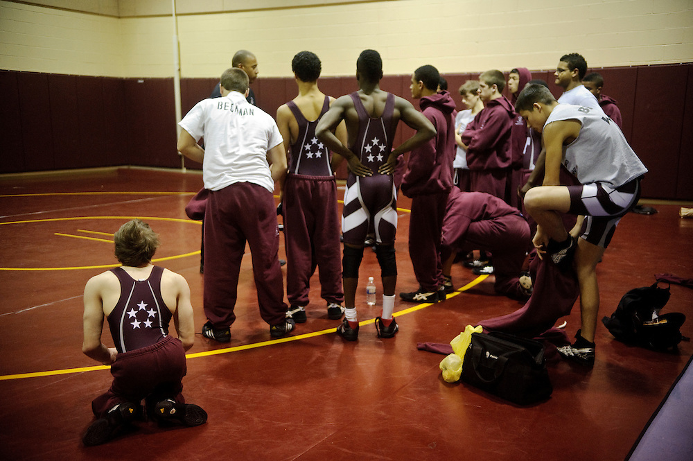 (staff photo by Matt Roth)..Cliff McCormick, Towson's 103-pound.wrestler .cerebral palsy .cannot use his legs..Asst. Coach Martin Brakke.head coach Phil Simmonds .New Town High School .Thursday, January 21, 2010.