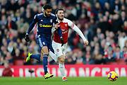 Arsenal defender Sead Kolasinac (31) battles with Fulham defender Cyrus Christie (22) during the Premier League match between Arsenal and Fulham at the Emirates Stadium, London, England on 1 January 2019.