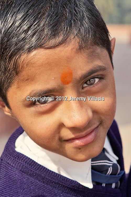 Portrait of a school boy with bindi