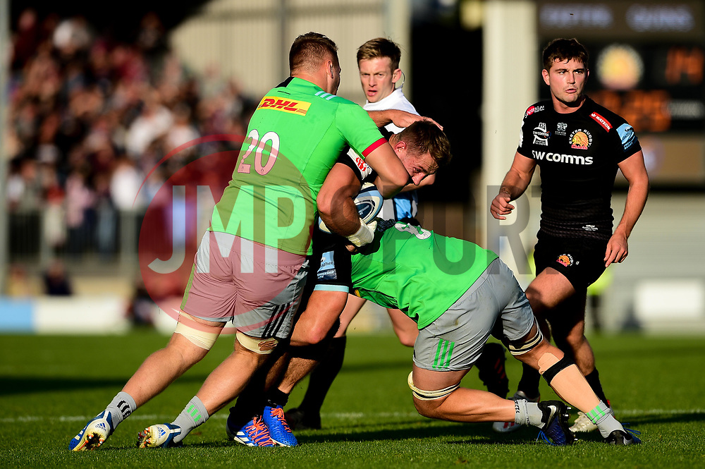Sam Hill of Exeter Chiefs is tackled by Alex Dombrandt of Harlequins and Tom Lawday of Harlequins - Mandatory by-line: Ryan Hiscott/JMP - 19/10/2019 - RUGBY - Sandy Park - Exeter, England - Exeter Chiefs v Harlequins - Gallagher Premiership Rugby
