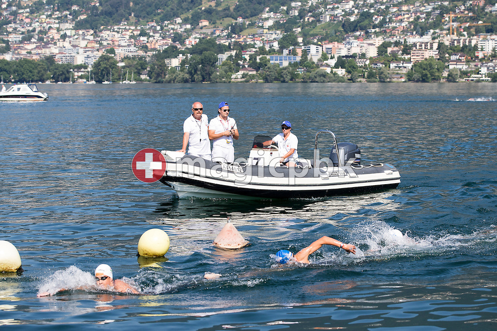 Referees on a boat follows the Youth boys 5km race during the LEN European Junior Open Water Swimming Championships held in the lake Maggiore (Lago Maggiore) at the Centro sportivo nazionale della gioventu in Tenero, Switzerland, Saturday, July 11, 2015. (Photo by Patrick B. Kraemer / MAGICPBK)